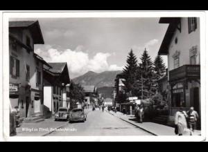 Österreich, Wörgl, Bahnhofstrasse m. Personen u. Oldtimern, 1951 gebr. sw-AK