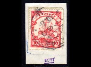 Togo 22, 10 Pf. m. WZ auf kl. Briefstück m. Stempel NUATJÄ. Geprüft.